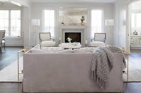 room french style furniture bensof modern:  room features a modern limestone fireplace positioned below an antiqued inset mirror flanked by long windows fixed behind white and gray french chairs