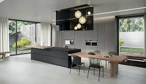 dining table interior design kitchen: kitchen island that offers an extended dining table in wood decoist kitchen island table design and modern kitchens