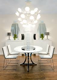 art deco miami style inspiration for a contemporary dining room remodel in miami with dark hardwood art dining room furniture