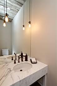 impressive edison light fixtures in powder room farmhouse with industrial bathroom next to frameless bathroom mirror bathroom pendant lighting fixtures