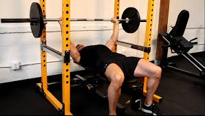 Image result for powerlifter bench press in power rack