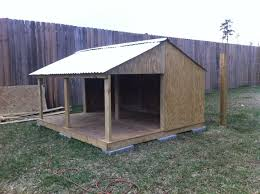 Help on Designing a Dog House   TexAgsIt has a removable wall  not shown    a doggie door that I install in the winter  The pad is     x      and it still has a     x      cover porch when the wall