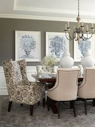 pictures of dining room decorating ideas: dining room walls in deep gray provide background for a grouping of large scale art