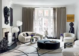 how to incorporate ottomans into your living room decor photos architectural digest architectural digest furniture