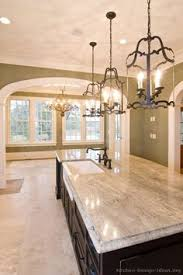 kitchen idea of the day traditional black kitchens gallery love the wrought iron pendant lights over the island black kitchen island lighting