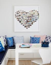 home office with heart shaped polaroid photos blonde wood office