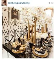 dramatic art deco inspired tablescape with black and gold accents artdeco art deco inspired pinterest
