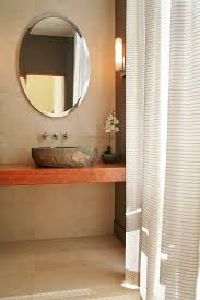 house on lake michigan minimalist powder room photo in milwaukee with a vessel sink and wood bathroom basin furniture