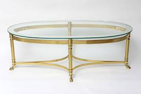 glass top oval mirrored coffee table with brass frame and legs on wheels for living room design ideas brass furniture