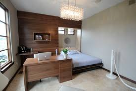jerry bussanmas contemporary guest bedroom idea in cedar rapids with travertine floors bed in office