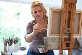 portfolio careers an artist paints a picture in her studio