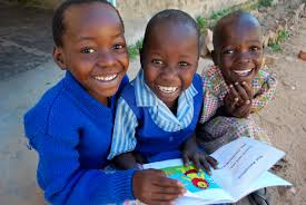international day of happiness good news stories on poverty one children reading at the matau primary school zimbabwe