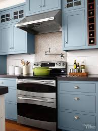 painted blue kitchen cabinets house: contrasted with white shiplap siding and concrete counters the beachy blue hue takes center stage in this kitchen without overwhelming paint color