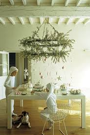 d decor furniture: christmas tea under an olive branch decorated candelabra photo by frederic vasseur the interior d decor