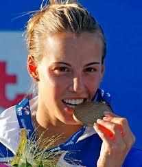 Tania Cagnotto. L'azzurra Tania Cagnotto con la medaglia conquistata a Roma. L'Italia vince la prima medaglia ai Mondiali di nuoto in corso a Roma: ... - tania_cagnotto_medaglia_bronzo_06
