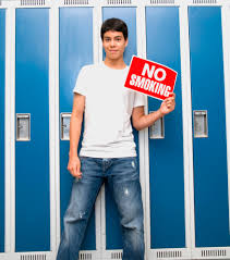 peer pressure is weaker for kids to quit smoking penn state teenage boy in front of lockers holding no smoking sign
