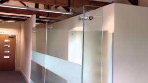 full fit out office furniture installation from aci with frameless glass partitions interior designer bright office room interior