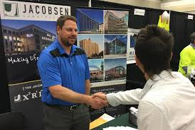 utah s largest job fair to be held in provo the daily universe a student meets a representative from jacobsen construction at a previous utah community job fair this year s event is going to be utah s largest