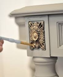 tutorials is from kate at centsational girl where she simply uses a dry brush technique using rub n buff in gold leaf to highlight a carved area on a centsational girl painting furniture
