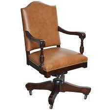 antique classic swivel desk leather armchair with casters c at deskscombinationdesks658199kiseries90extendedtabletarmchair antique leather swivel desk chair