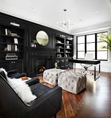 tan leather office chair in home office transitional with black millwork black and white animal hide rugs home office traditional