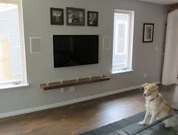 For Floating Shelves In Living Room Stunning Woods Floating Shelves Under Large Lcd And Cool Family
