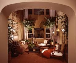 tropical living rooms: tropical themed living room design with tall ceiling trees plants and formal tropical furniture