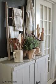 vintage decor clic: vintage linens and wooden utensils displayed in the kitchen on a rustic sideboard via