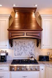 cherry double shaker cabinets kashmir gold kashmir gold granite countertops with a natural stone backsplash frame