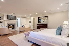 big master bedrooms couch bedroom fireplace: this light and airy contemporary master bedroom combines light hardwood floors with light upholstered furniture and