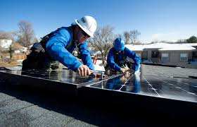 solar energy jobs booming in u s arizona seeing benefits two lighthouse solar employees install microcrystalline pv modules on top of a colorado townhome in