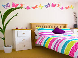 girls room decor ideas painting: terrific girls room paint ideas with wooden headboard plus wooden floor also beautiful butterfly art painting
