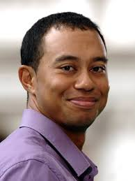 Tiger Woods smile. Source: WENN.com - tiger_woods_smile