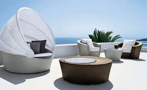 attractive modern outdoor furniture by applying unique chair and round shaped coffee table charming outdoor furniture design