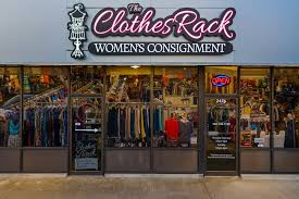 the clothing rack of an iron art store shows the vintage shelf clothes island in a console