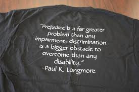 prejudice is a far greater problem than any impairment this black t shirt neatly printed white letters offers a quote from paul