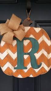 painted front door decor ideas make a faux monogrammed pumpkin from a wood board