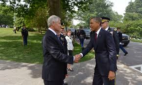 u s department of defense photo essay defense secretary chuck hagel shakes hands president barack obama as he arrives to join hagel