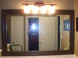bathroom vanity mirrors and decorating ideas with brown wooden frame plus cabinet and lighting also bath cabinet and lighting