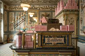 spoiler alert you can t really stay at the real grand budapest mendl s light pink boxes adorn the furniture inside pfunds molkerie photography by 20th century fox