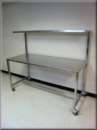 stainless kitchen work table: image of stainless steel work bench on wheel