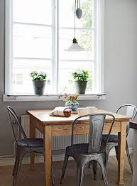 dining table interior design kitchen: square wooden dining table metal cafe chairs indoor plants large