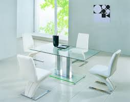 clear glass dining table and 4 chairs