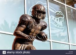 tim griffin stock photos tim griffin stock images alamy bust of bronze statue of tim tebow heisman trophy winner stands in front of