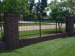 Small Picture Wrought iron fencing with brick border Wrought iron fencing