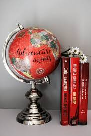 adventure awaits large red globe calligraphy travel quotes silver chrome base brightly colored offices central st