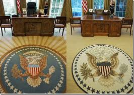 the quotes on obamas rug on the right above are sewn around the perimeter of the rug and are non partisan two are from democratic presidents bill clinton oval office rug
