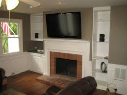 living room wall mounted tv beverly large tv over fireplace woodbridge ct mount tv above fireplace richey