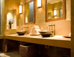 design basin bathroom sink vanities: round steel basins sit atop a simple ledge vanity though it lacks drawer space