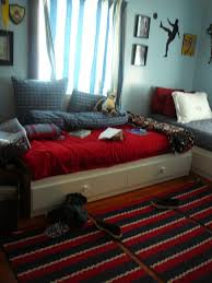 fascinating 10 year old boy bedroom ideas using red and gray white beds combined with red striped rug and blue wall also wood floor astonishing boys bedroom ideas
